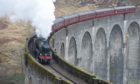The Glenfinnan Viaduct between Fort William and Mallaig as the Jacobite Express steam train makes its first run of the season due to Covid-19.