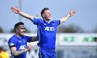 Mitch Megginson celebrates his second goal for Cove against Falkirk.