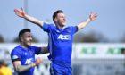 Mitch Megginson celebrates his second goal for Cove against Falkirk.