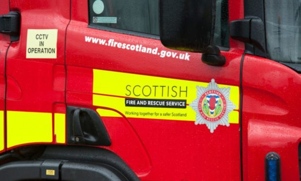 """Firefighters were seen battling to control the flames, which were """"well established"""" through the car when they arrived at the scene, south of Fyvie."""