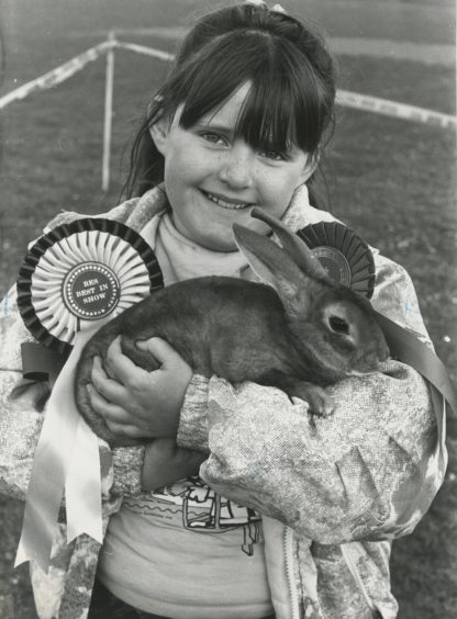 1989 - Claire McGregor  Cove Bay Gala pets parade. Claire McGregor (8), of Langdykes Crescent, Cove, show off her rabbit Rogina, first in the any variety section.   Used: EE 02/06/1989