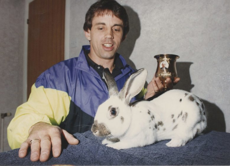 """1991 - Gary Robertson (pictured) North-east rabbit breeder and exhibitor Gary Robertson has become only the second Scot in 70 years to win the Scottish, English and Dutch Rabbit Club's coveted Gold Cup. And his prizewinning young buck gained the award after only two years of club competition. Some breeders have tried for decades to win the cup but success depends on entering a rabbit with markings as close as possible to the definitive English butterfly smut pattern. Aberdeen born Gary (37) is pool supervisor at Ellon and lives in the town's Modley Avenue. He won the Gold Cup at the recent National English Rabbit Show at Thirsk, Yorkshire. And the big success came only weeks after the same rabbit won another major award - to keep it in the family. The buck bounced off with the Gary and Sheila Robertson Rosebowl as best in show for under five month stock at the Scottish championship show in Dunfermline."""""""