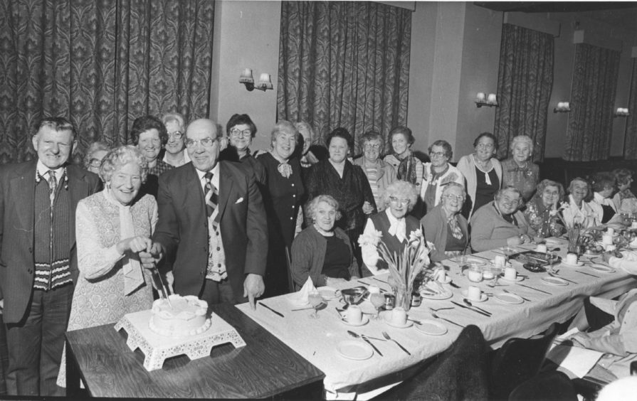 1983 - Founder member and social convener of Seaton Community Centre Mrs Mary Jack cut the centre's 35th birthday cake at their party in the Jubilee Lounge, King Street, Aberdeen. And helping her to do the honours is another founder member president Bill Tough.