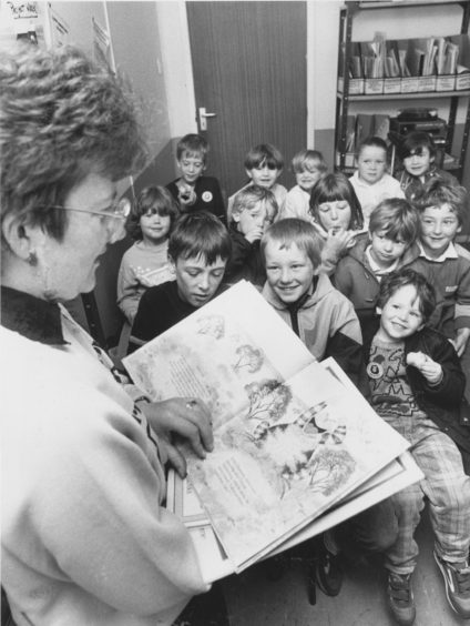1987 - It's story time (above) as librarian Moira Keay entertains a happy group of local youngsters enjoying themselves during the weekend's Seaton Community Festival.