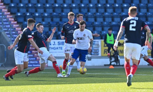 Cove striker Mitch Megginson takes on the Falkirk defence.