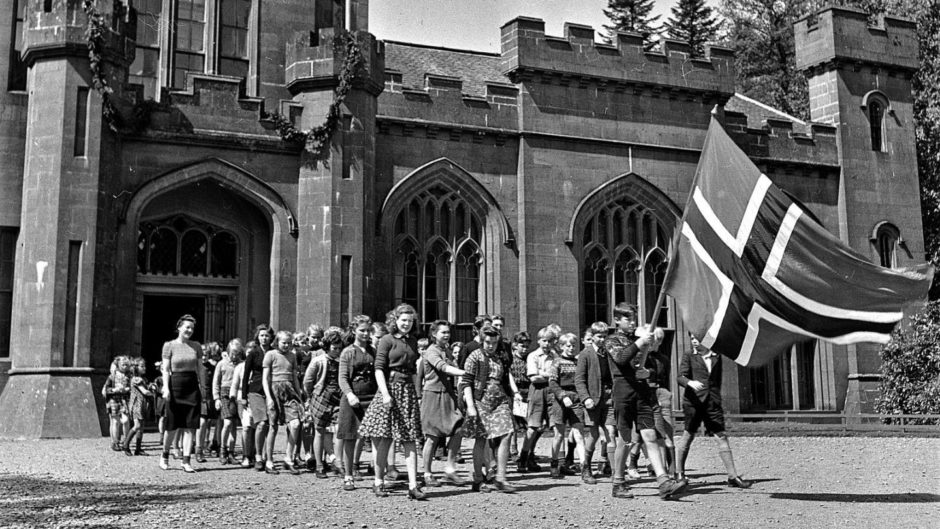 Norwegian children proudly march with their national flag at Drumtochty Castle - their refuge and school during the Second World War.