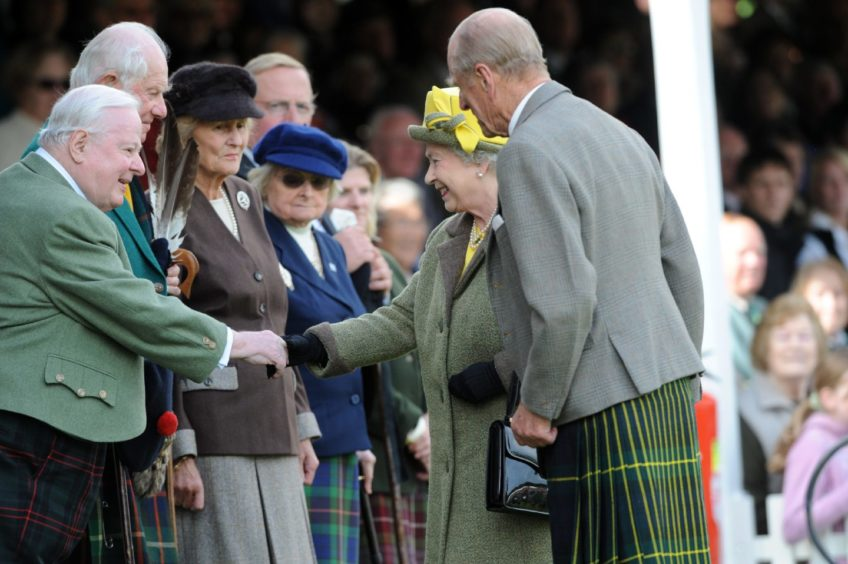 The Queen and Prince Philip speaking to their guests at the Braemar Highland Games 2009. Picture by Raymond Besant.