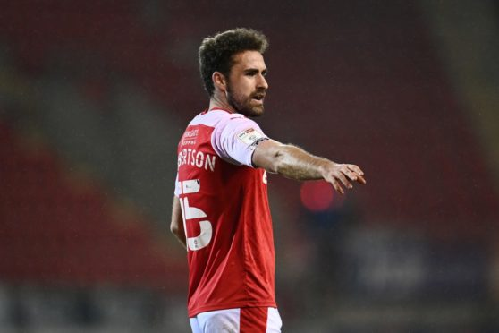 Rotherham defender Clark Robertson has been linked with a Dons return.