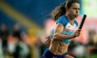 Zoey Clark takes the baton for the British 4 x 400 ladies team at the World Athletics Relays in Silesian Stadium, Chorzow, Poland.