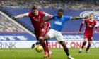 Aberdeen's Ash Taylor tangles with Rangers' Jermain Defoe at Ibrox on November 22.