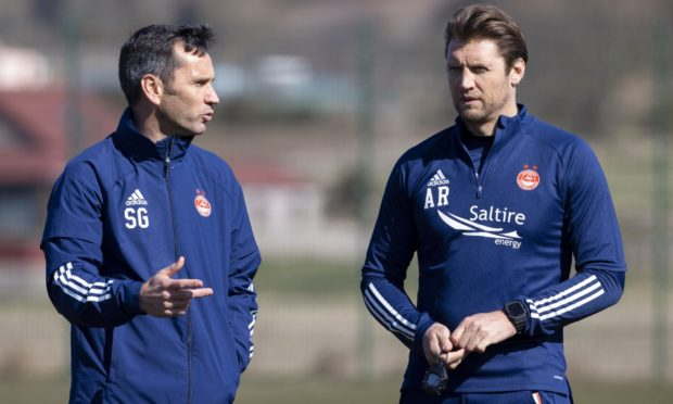 Aberdeen manager Stephen Glass and assistant Allan Russell.