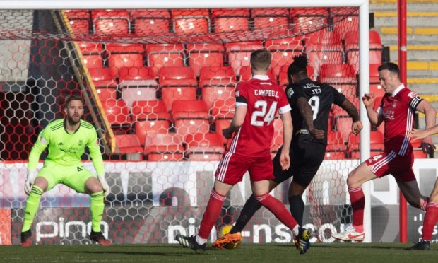 Jay Emmanuel-Thomas scores to make it 1-0 Livingston during a Scottish Cup against Aberdeen.