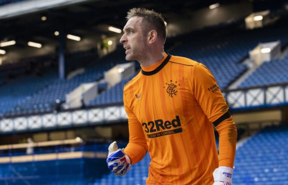 Rangers' Allan McGregor celebrates after saving a penalty during a Scottish Cup tie against Celtic.
