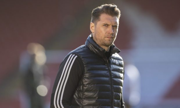 Aberdeen assistant manager Allan Russell in the 1-1 draw with Celtic at Pittodrie.