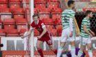 Aberdeen midfielder  Lewis Ferguson celebrates making it 1-0 against Celtic.