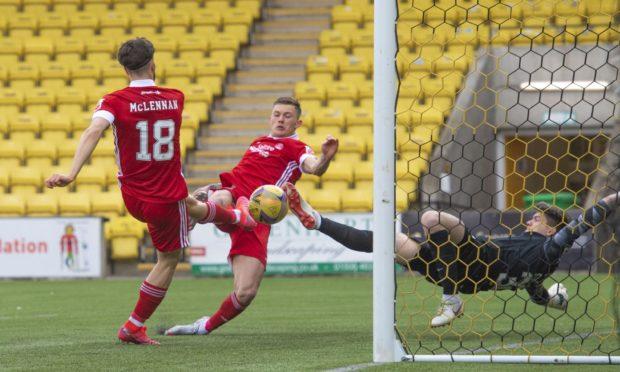Callum Hendry, centre, scores for Aberdeen against Livingston.