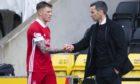 Aberdeen manager Stephen Glass with goalscorer Callum Hendry.