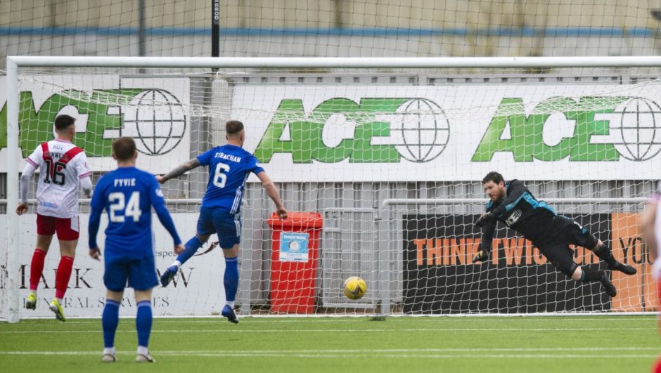 Callum Gallagher's shot loops off Ross Graham over Cove goalkeeper Stuart McKenzie.