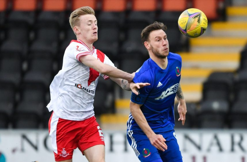Airdrie's Kyle Turner (L) and Cove's Mitch Megginson.