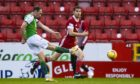Hibernian's Christian Doidge scores the winner against Aberdeen.