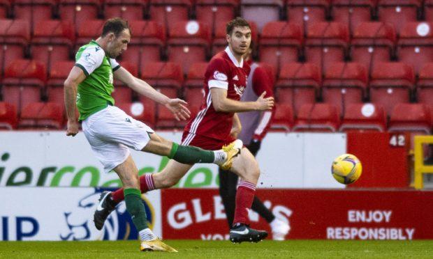 Hibernian's Christian Doidge scores the winner against Aberdeen.