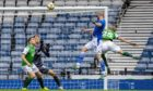 St Johnstone's Shaun Rooney heads home past Hibernian's Matt Macey to make it 1-0 during the Scottish Cup final match between Hibernian and St Johnstone at Hampden Park.