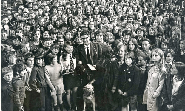 1970: Hilton Secondary School pupils with Mr J. Skinner and his dog Jasonu after a £250 cheque for the Guide Dogs for the Blind Association had been handed over by Freda Ritchie in Hilton School hall, Aberdeen, yesterday.