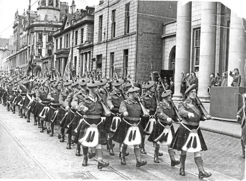 1949: The Gordon Highlanders TA marching down Union Street, Aberdeen, with their colours in 1949.'