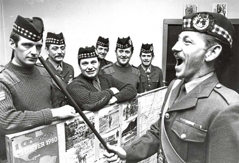 1980: Sergeant Major Lennie Lowe puts some bite into the proceedings at the Gordons Highlanders regimental study day in the Hardgate, Aberdeen.  He told the lads that it wont be all sunshine and glamour in their Belize tour in the Caribbean in the spring. And just to keep them in order Sgt.-Maj. Lowe, from Aberdeen, will be going along as well. Gordon Highlanders from throughout the country were meeting in Aberdeen today to co-ordinate the regiments recruiting campaign.