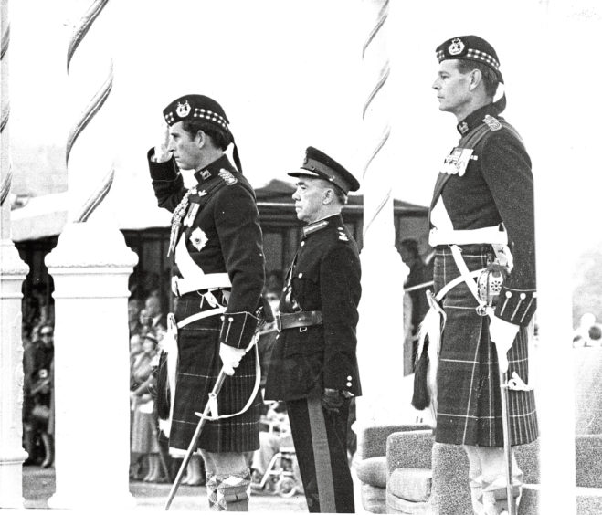 1982: Taking the salute  (left to right) Prince Charles, Aberdeens Lord Provost Alex Collie and Colonel of the Regiment Maj. Gen. J. R. A. MacMillan. The Gordon Highlanders gave a Royal salute to the Prince of Wales in Aberdeen last night. Thousands of people crowded into the city's Duthie Park to watch as Prince Charles, Colonel-in-Chief of the Gordon Highlanders, took the salute at the Trooping the Colour.