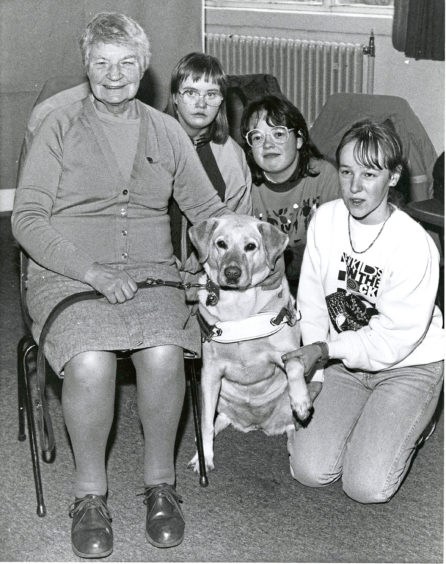 1991: Guide dog Heidi was the centre of attraction when her mistress Miss Isobel Mundie visited Aberdeen College of Further Education's Ruthrieston Centre. Students on the special educational needs extension course have been collecting foil and used stamps in support of Guide Dogs for the Blind and Miss Mundie called to receive them. With them are students Brenda Hay (right), Davene MacDonalds (centre) and Mairi Kinnaird.