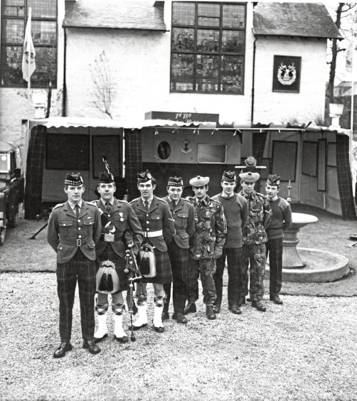1972: Line-up shows the team who will man the new office. Left to right  Pte. Dougie Keith, Strichen; Piper John Lovett, Bridge of Don; L./Cpl. David Taylor, Whiterashes; Pte. Norman Cooper, Pte. Mike Duff, L./Cpl. Charlie Ashe, L./Cpl. Andy Ballantine, and L. Cpl. Gordon Philip, all of Aberdeen. Its goodbye to that all too-familiar picture of Army recruiting with a sergeant and a couple of men standing by wind-blown tartan-covered table in the village square. From now on, the Gordon Highlanders go modern with a mobile recruiting office, the first one in the history of the regiment. It contains everything an enlisting team might need, including mini-cinema.