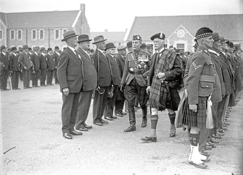 """1935: At the opening of the new barracks at Bridge of Don in 1935, the Marquis of Huntly and Brigadier General Hamilton inspect the Old Gordons."""" """"Barracks open: Veteran Gordon Highlanders stand proudly to attention as they are inspected at the opening of the Bridge of Don Barracks, Aberdeen, in 1935. Surveying the ranks of old heroes are the Marquis of Huntly and Brigadier General Hamilton."""