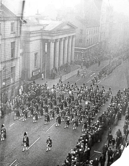 1961: In the frosty haze of a November day, with bayonets fixed, drums beating and colours flying, the Gordon Highlanders swing proudly up Union Street, Aberdeen, yesterday, to the stirring tune Cock o the North. Big crowds lined the streets to watch the ceremonial associated with the laying up of the colours.