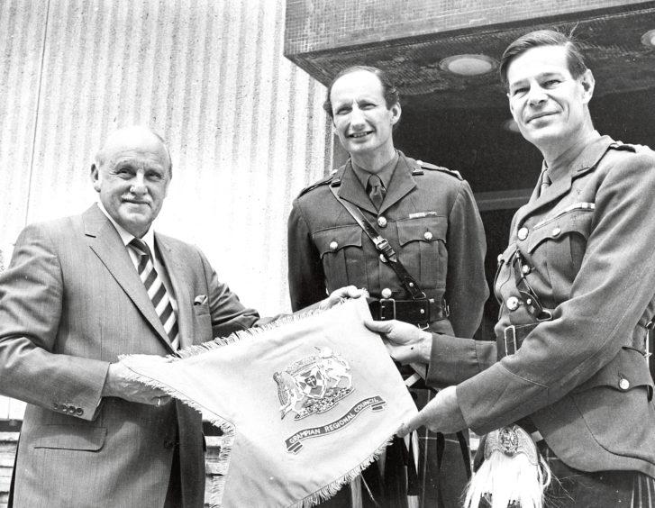 1980: Mr Sandy Mutch, convener of Grampian Regional Council, Col. C. H. Van der Noot, CO. 1st Battalion The Gordon Highlanders (left) and Brigadier John R. A. Macmillan, Colonel of the Regiment, admire the Pipe Banner.