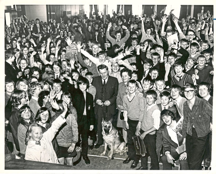 1970: Pupils of Summerhill Secondary School, Aberdeen, easily beat their target of £250 a train a guide dog for the blind under the Pearl Murray Project. At a ceremony in the school hall yesterday Miss Margraet Benson, of the Guide Dogs for the Blind Association, presented the school with a statuette, which is being held aloft by Keith Buchan, of Class 1G, as the other pupils cheer. In the centre of our picture with Miss Benson is Mr Alex Duguid, Scottish area organiser, with his dog, Shuna.