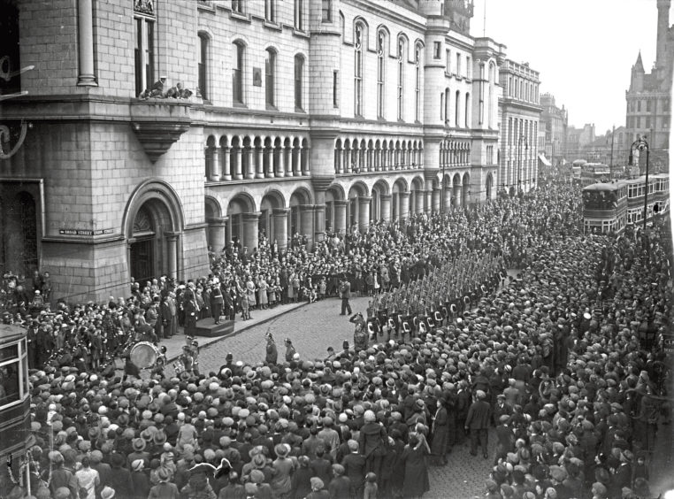1935: The Gordon Highlanders marching through Aberdeen on their way from their Castlehill Barracks to their new barracks at Bridge of Don, in 1935.