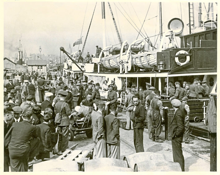 """1997: Gordon Highlanders going aboard the St Rognvald at Aberdeen Harbour en route for Scapa Flow?"""" """"Unloading a ship in Aberdeen Harbour in the steam age"""