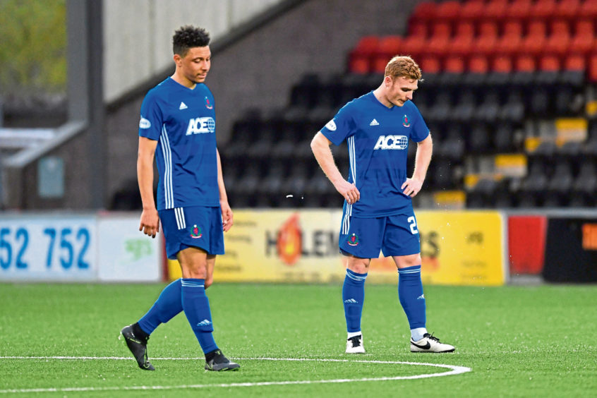 Cove's Fraser Fyvie (R) and Leighton McIntosh after the defeat to Airdrieonians.