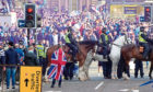 Police Scotland mounted officers block access to George Square in Glasgow city centre where Rangers fans celebrated.