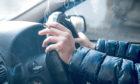 Man smoking at the wheel