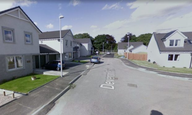 Man charged after police officer assaulted during early morning house fire in Deveron Park