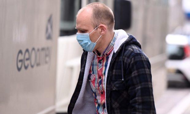 Michael Tonberg leaving court.
