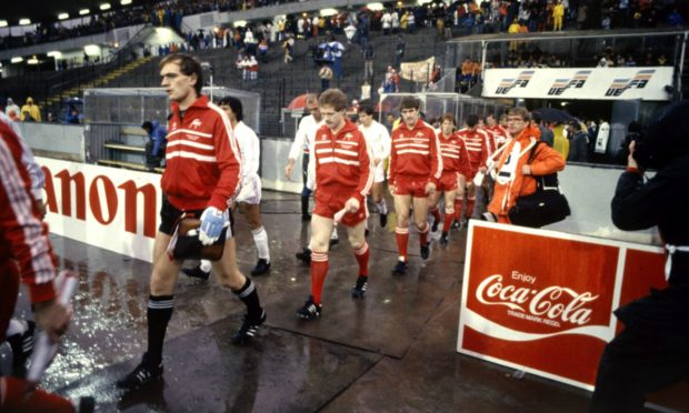 The Dons and Real Madrid players take to the field in the Ullevi Stadium, Gothenburg. Dons players from the left, Jim Leighton, John McMaster, Mark McGhee and Gordon Strachan.