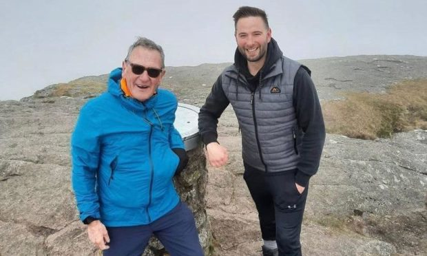 To go with story by Ellie Milne. Neil McArthur is climbing Bennachie every day in May to raise money for charity. Picture shows; Neil McArthur and Ben Riddell at Bennachie. Bennachie. Supplied by Ben Riddell Date; 08/05/2021