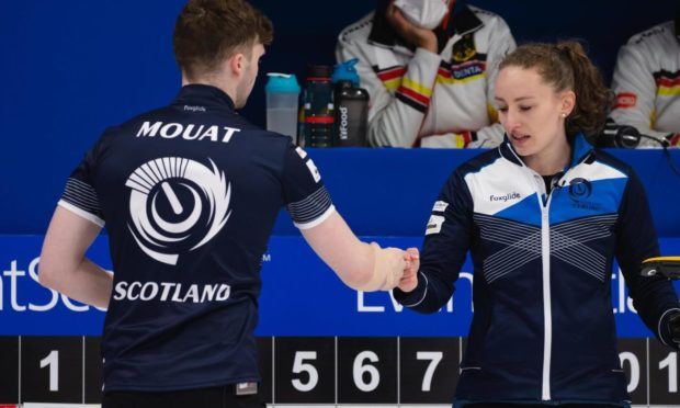 Bruce Mouat (left) and Jen Dodds shake hands following Scotland's 7-4 victory over Canada at the Curling World Championships in Aberdeen.