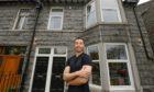 房地产开发商刘强森(Jonathan Lau)将一座旧宾馆改造成了豪华公寓。
