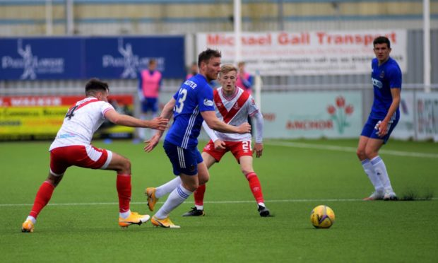 Cove's Rory McAllister in action against Airdrieonians.