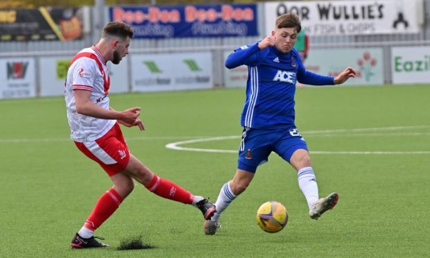 Connor Smith of Cove Rangers, right, in action against Airdrieonians.