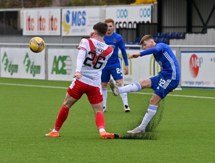 Cove's Connor Smith tries to find a teammate against Airdrieonians.